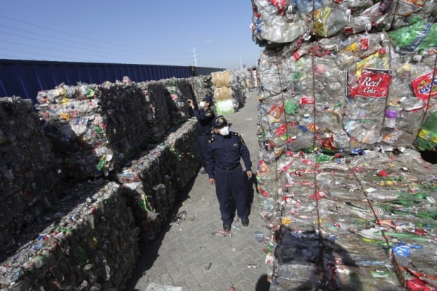 Customs officers check on imported solid waste at an examination centre in Qingdao, Shandong province