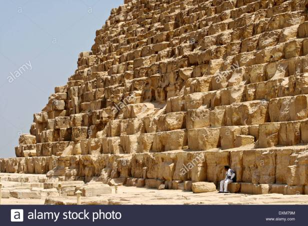 close-up-of-egyptian-pyramids-in-giza-cairo-egypt-with-guard-on-duty-dxm79m